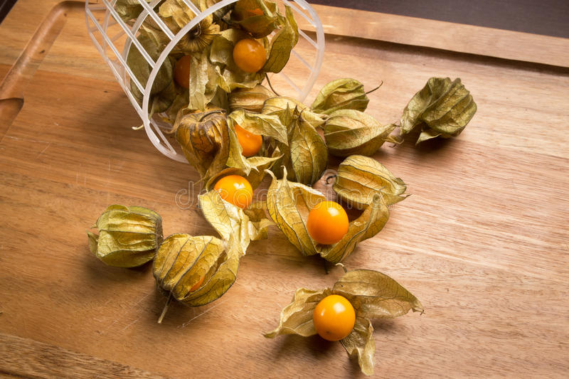 Physalis in a wooden tray stock images