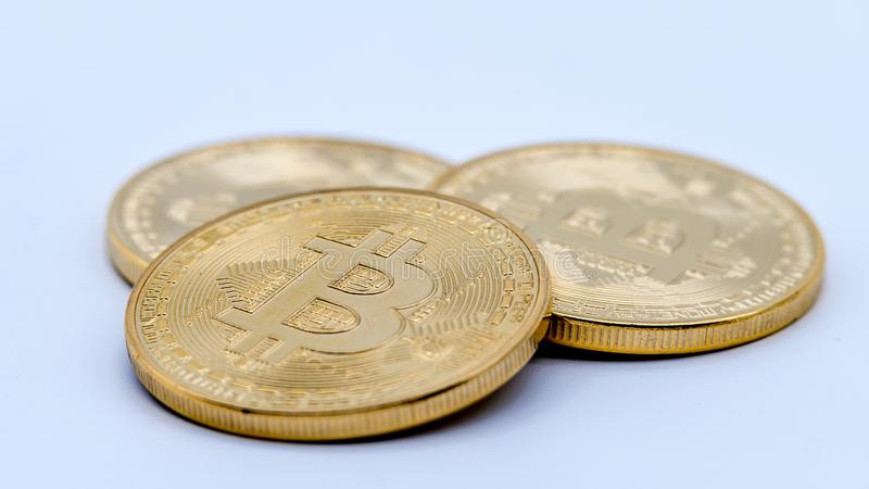 Physical metal golden Bitcoin currency, white background. Cryptocurrency royalty free stock image