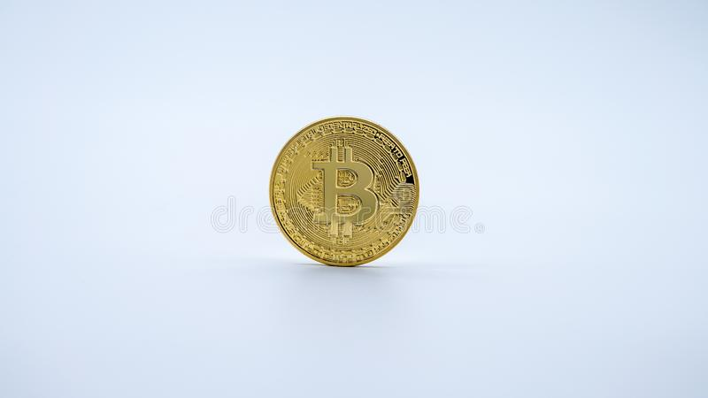 Physical metal golden Bitcoin currency, white background. Cryptocurrency stock photo