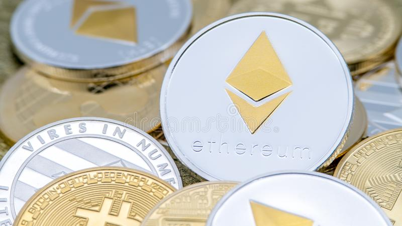 Physical metal silver Ethereum currency over others coins. Cryptocurrency royalty free stock images