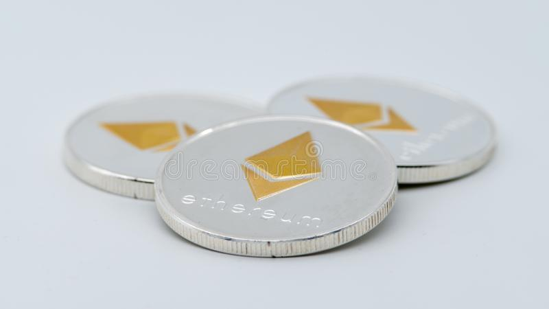 Physical metal silver Ethereum currency on white background. ETH coin stock photography