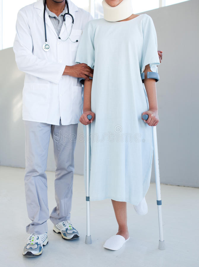 A Physical Therapist Helping A Patient On Cr Stock Photography