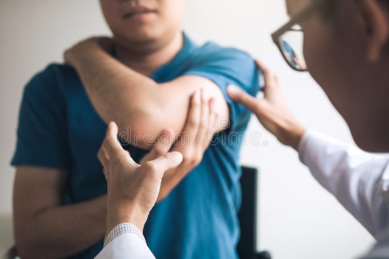 Physical therapists are checking patients elbows at the clinic office room.  stock photo