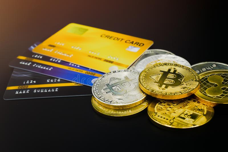 Physical version of bitcoin and leather wallet and credit card  that is a new virtual money world cryptocurrency and digital royalty free stock photography