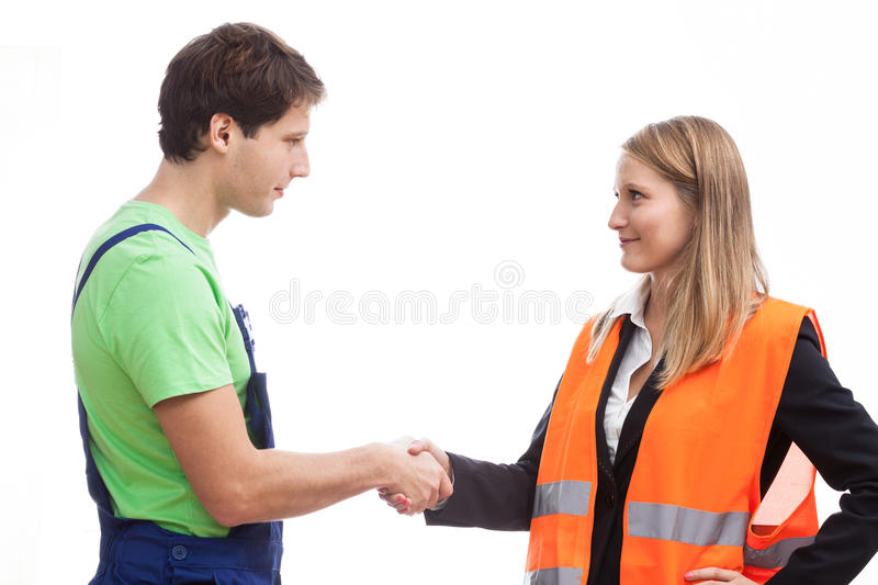 Physical worker with his boss stock photo
