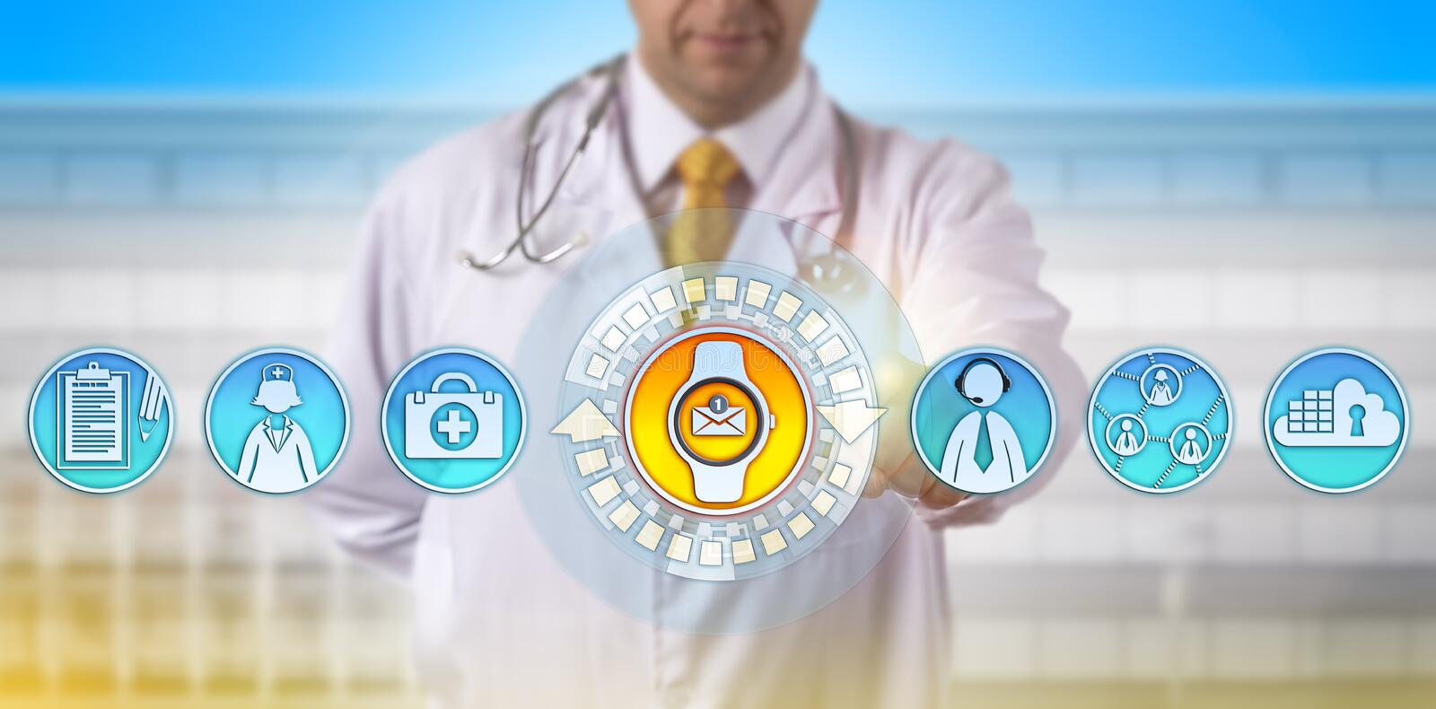 Physician Accessing E-Mail Update On Smartwatch. Unrecognizable physician accessing email update via smart watch on the move. Healthcare technology concept for royalty free stock images