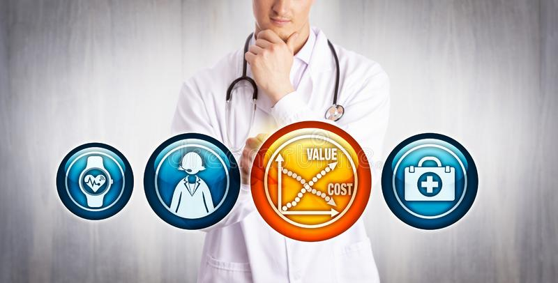 Physician Analyzing Value Vs Cost Of Telemedicine. Young physician analyzing reduction of cost versus rise of value of telemedicine. Healthcare and technology royalty free stock photography