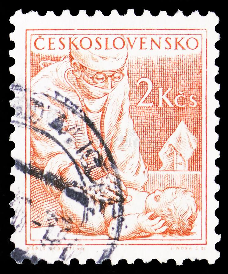Physician and baby, Paediatrician, Professions circa 1954. MOSCOW, RUSSIA - MARCH 30, 2019: A stamp printed in Czechoslovakia shows Physician and baby stock photography