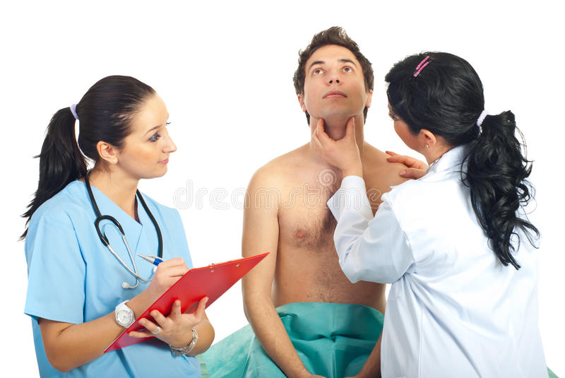 Physician woman examine neck male patient royalty free stock photo