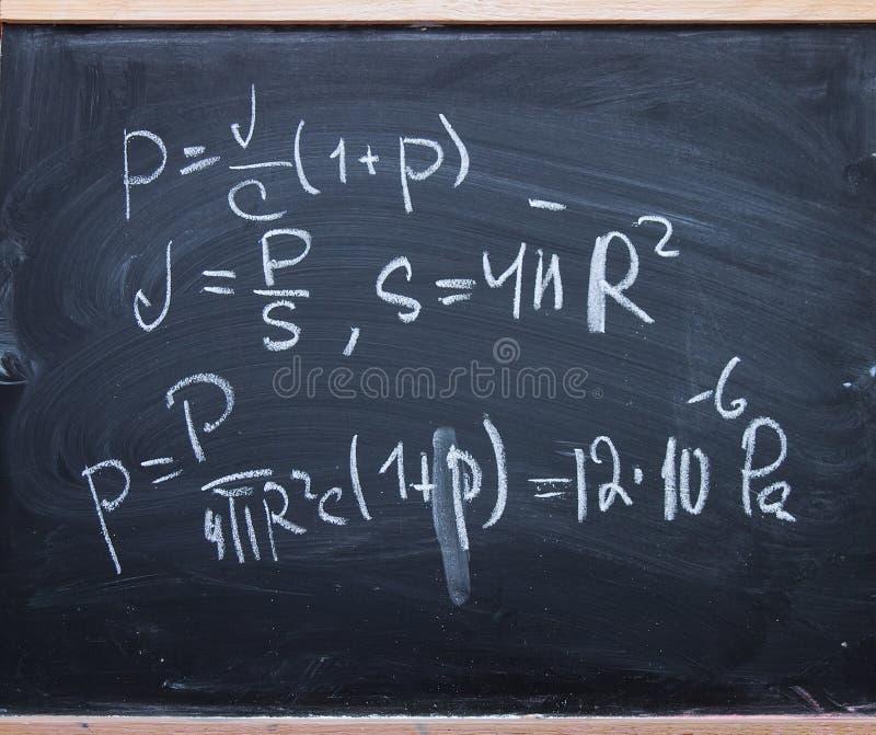 Physics formulas on blackboard royalty free stock photography