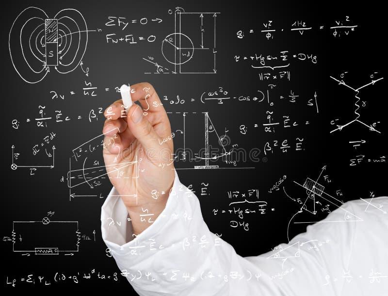 Physikdiagramme und -formeln lizenzfreie stockfotos
