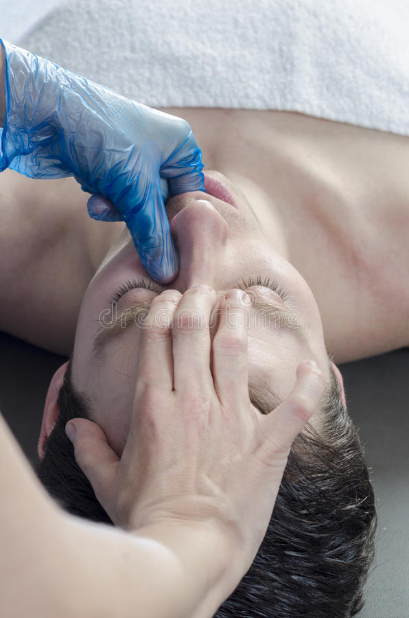 intraoral technique of masseter. royalty free stock images