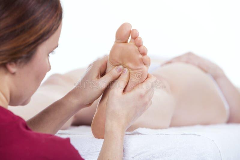 Physiotherapist doing plantar reflexology. Massage on one foot stock image