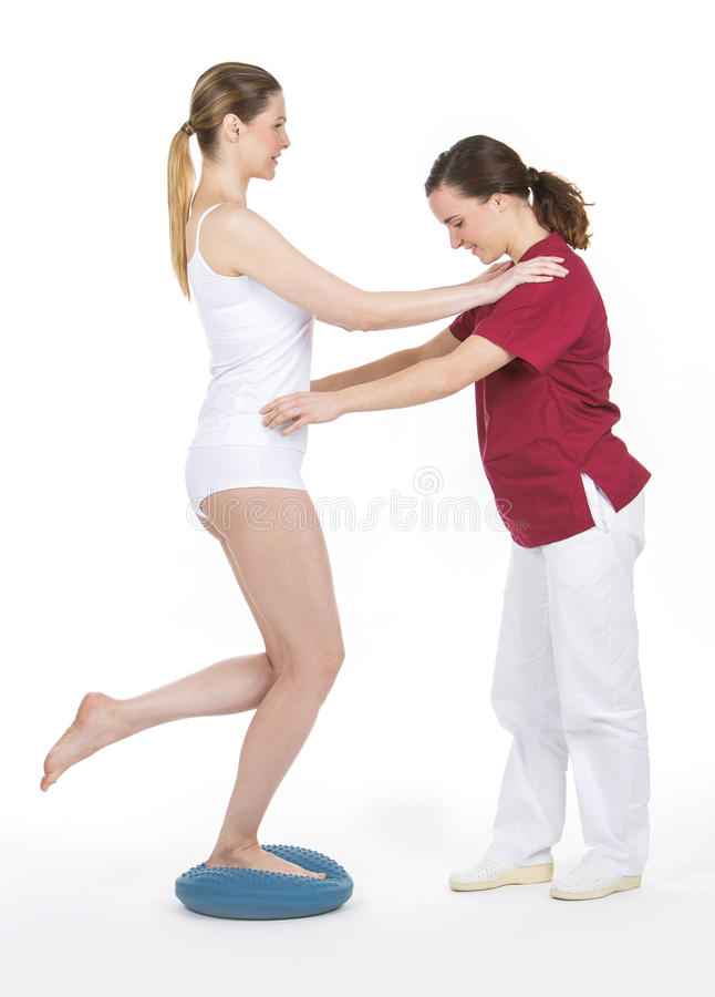 Physiotherapist doing a rehabilitation royalty free stock photography