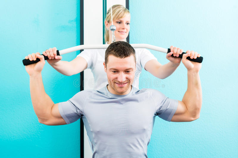 Physiotherapist doing sport rehabilitation with patient stock photography