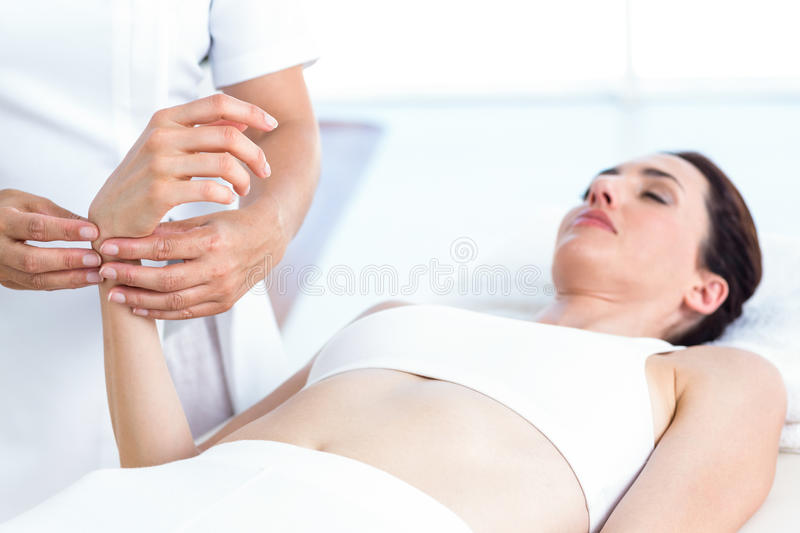Physiotherapist examining her patients wrist royalty free stock images