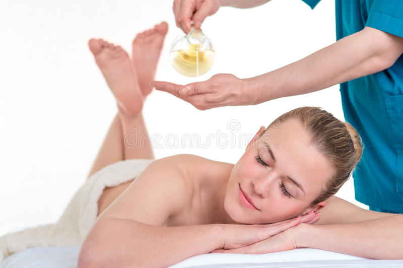 Physiotherapist giving back massage to a woman stock photo