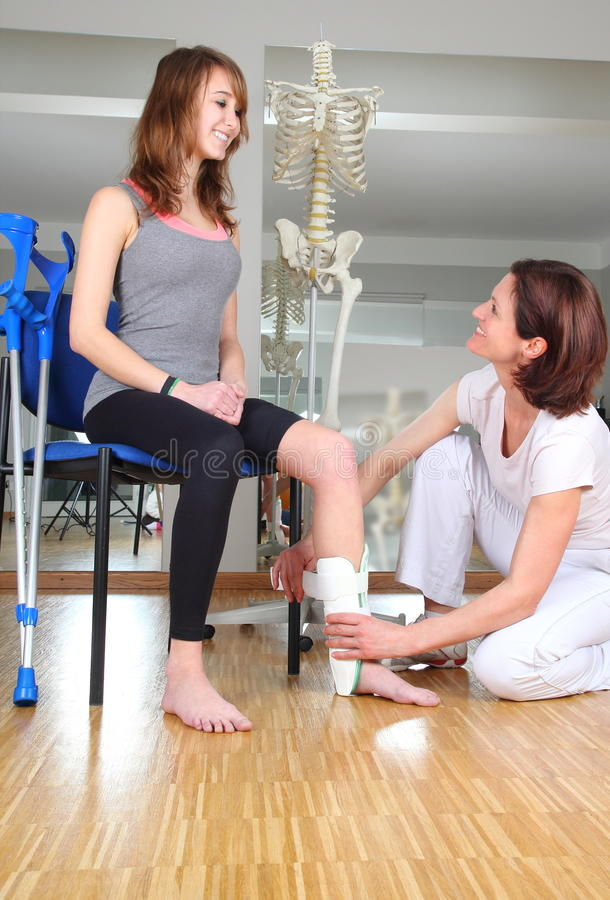 Physiotherapist and patient with knuckle injury. A Physiotherapist and patient with knuckle injury royalty free stock photo
