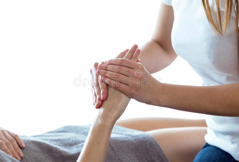 Physiotherapist pressing specific spots on female palm. royalty free stock photography
