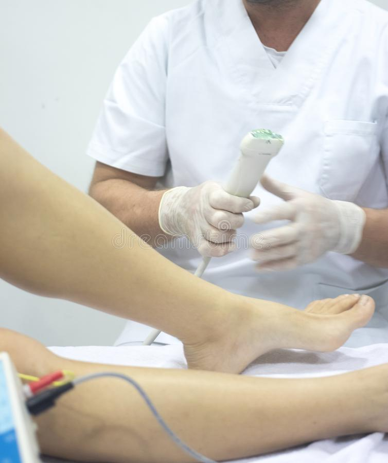 Physiotherapy medical clinic. Physiotherapy clinic Intratissue Percutaneous Electrolysis EPI dry needling physiotherapist patient injury stock images
