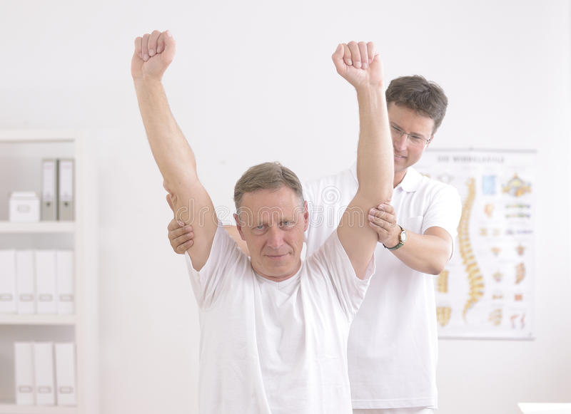 Download Physiotherapy: Senior Man And Physiotherapist Stock Photo - Image of patient, physical: 25210108