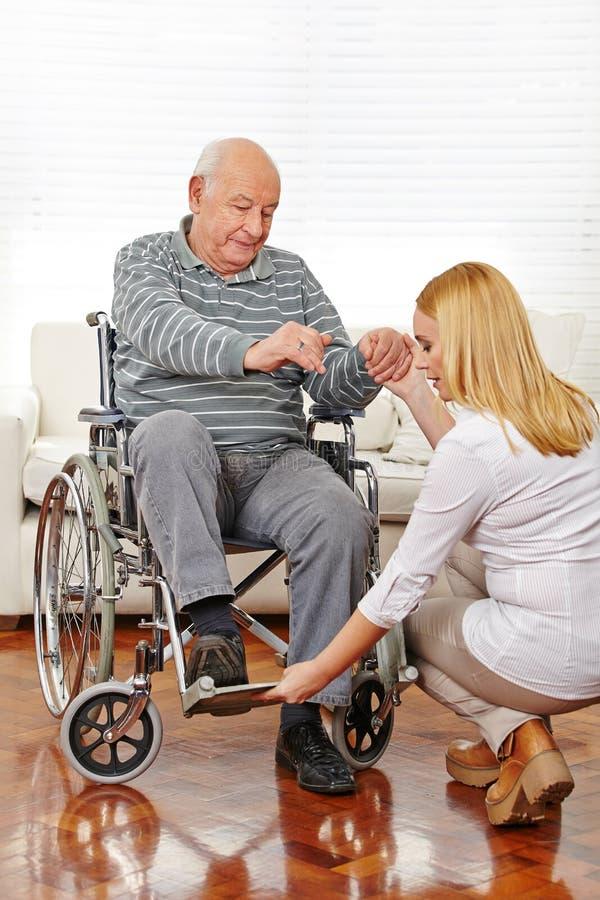 Physiotherapy with senior man royalty free stock photos