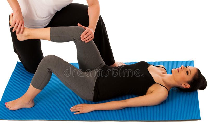 Physiotherapy - therapist doing leg stretching excercises with royalty free stock images