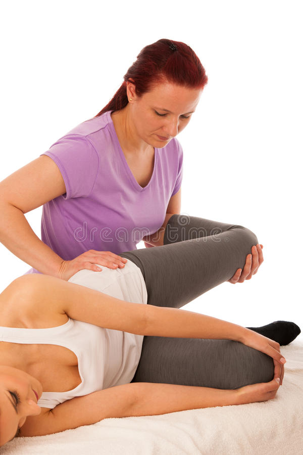 Physiotherapy -therapist excercising with patient , working on l stock image