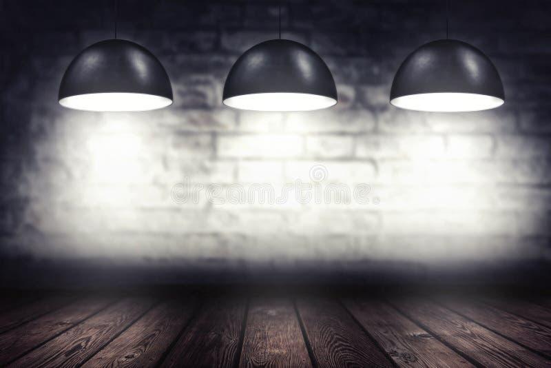 Pièce avec trois lampes de projecteur photographie stock libre de droits