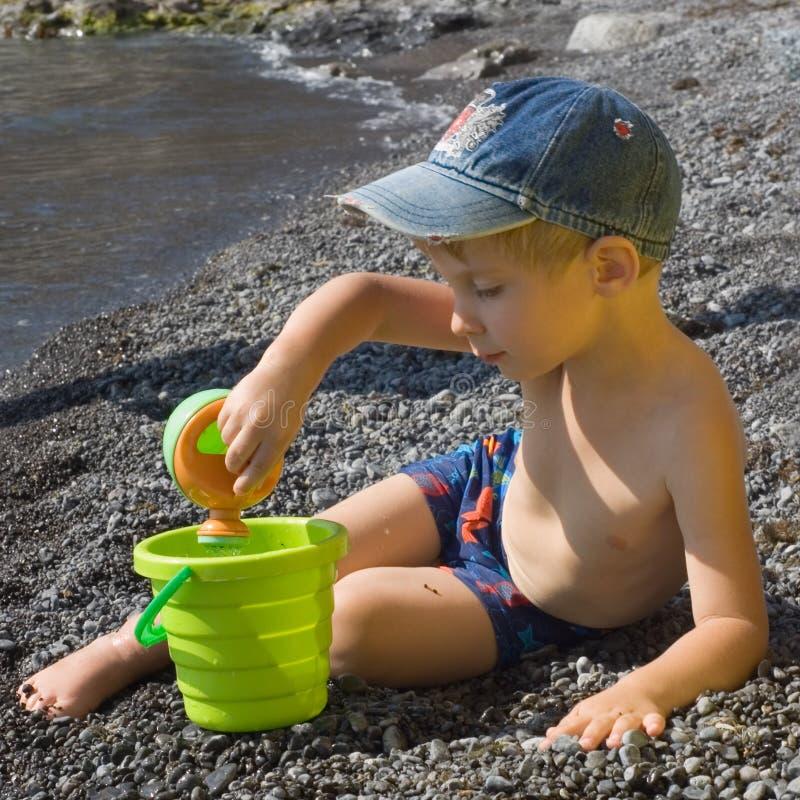 pièce de garçon de plage photo libre de droits