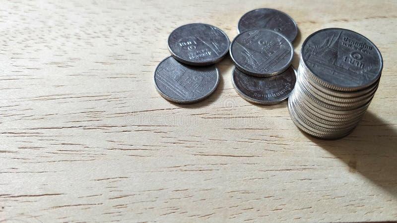 Pièce de monnaie accrue photo stock
