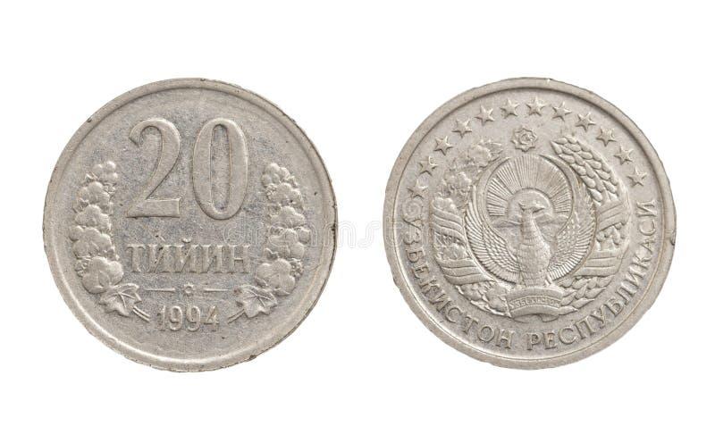 Pièce de monnaie d'Ouzbékistan sur le fond blanc photo stock