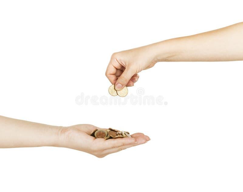 Pièce de monnaie de mise femelle dans une main de femelle de sécurité photos libres de droits