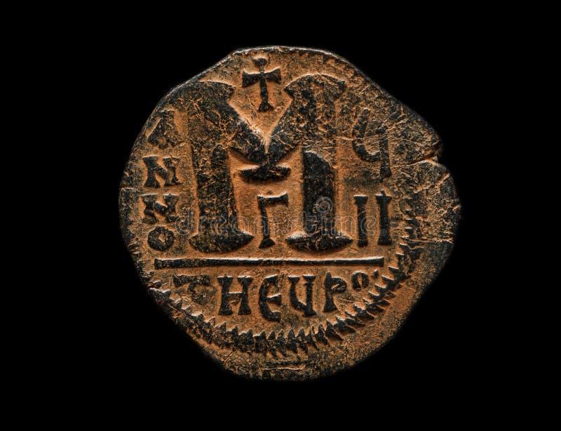 piece de monnaie avec un m