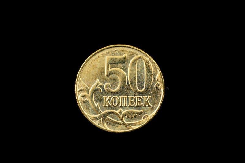 Pièce de monnaie de kopeck du Russe cinquante d'isolement sur un fond noir photos libres de droits