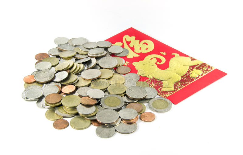 Pièce de monnaie thaïlandaise d'argent avec les paquets rouges chinois photographie stock libre de droits