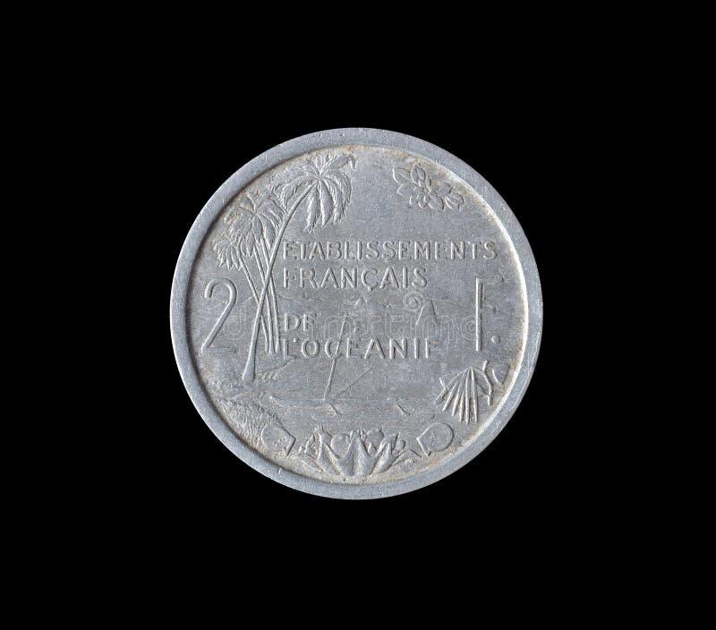 Pièce de monnaie de vintage faite par le Français Océanie photo stock