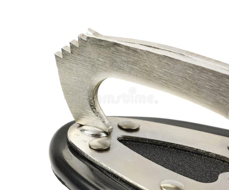 Pièce dentelée par avant en métal de lame des patins de figure, botte en cuir blanche de femme, vue de côté, sur le fond blanc d' photo stock