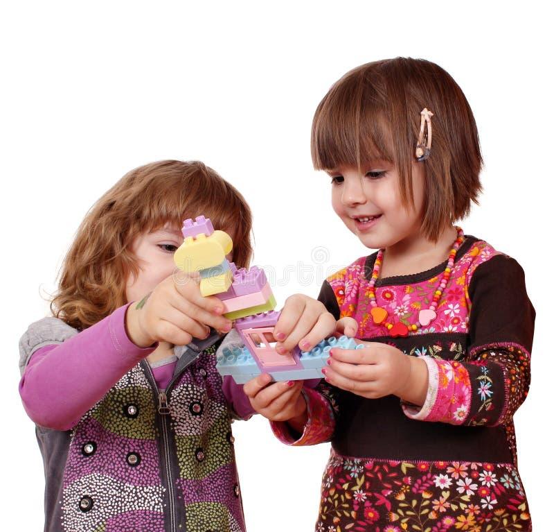 Pièce et amusement de petites filles image libre de droits