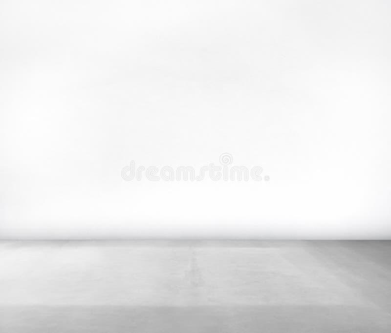 Pièce faite en mur blanc et plancher en béton photographie stock libre de droits