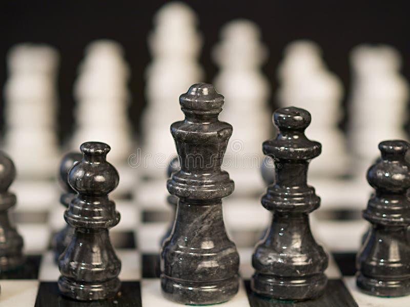 Pièces d'échecs de Bllack image stock