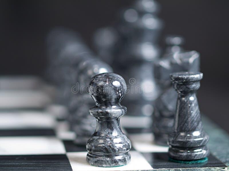 Pièces d'échecs noires photographie stock