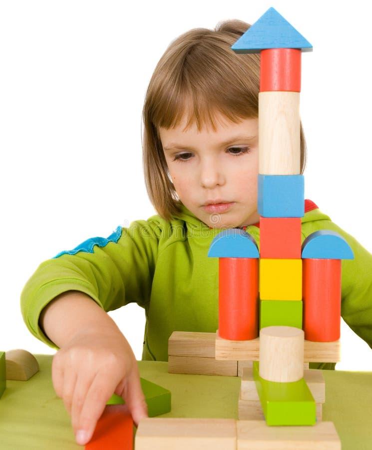 Pièces d'enfant avec des blocs de jouet photographie stock
