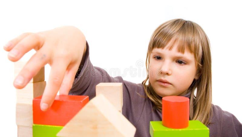 Pièces d'enfant avec des blocs de jouet photographie stock libre de droits