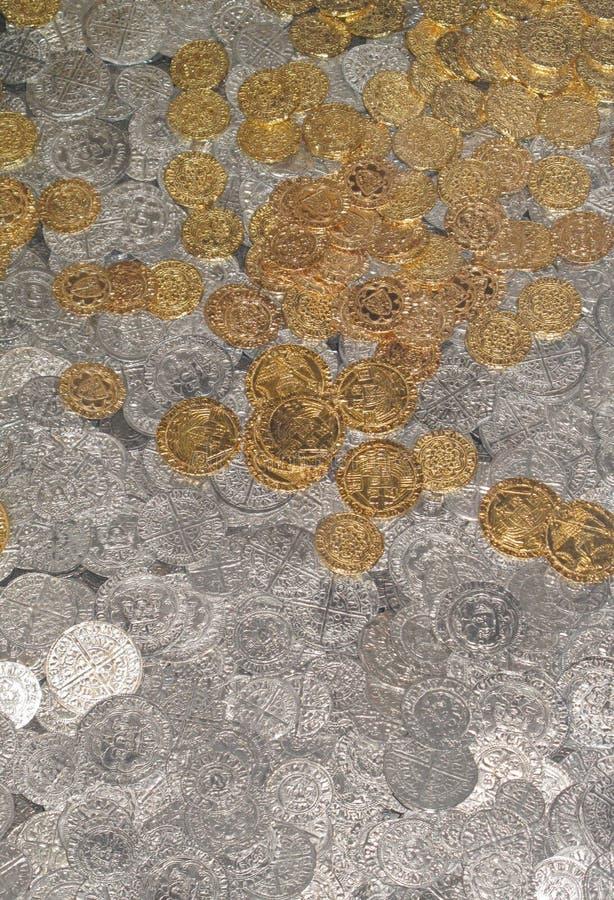 Pièces d'or et en argent photos stock