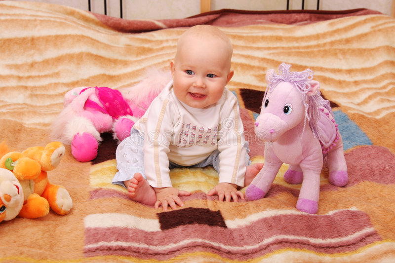 Pièces de chéri avec les jouets 4 photo stock