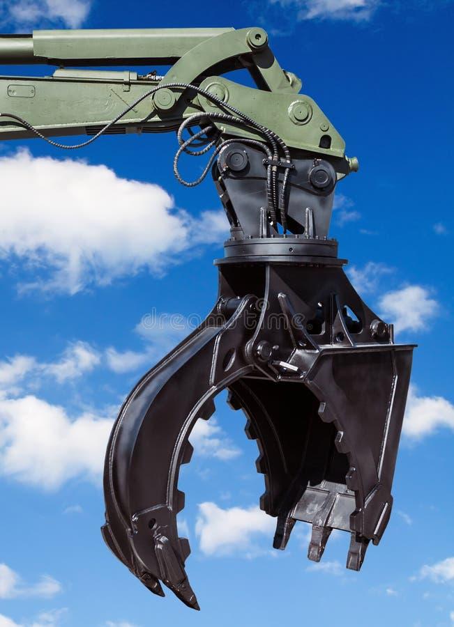 Pièces de machines de construction sur le fond de ciel bleu photos libres de droits