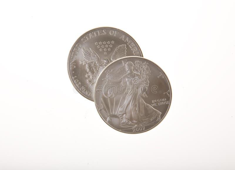 Pièces de monnaie argentées de liberté images stock