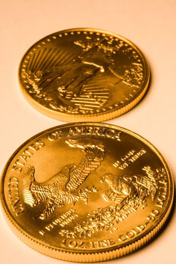 Pièces de monnaie de lingot d'or des Etats-Unis photos libres de droits