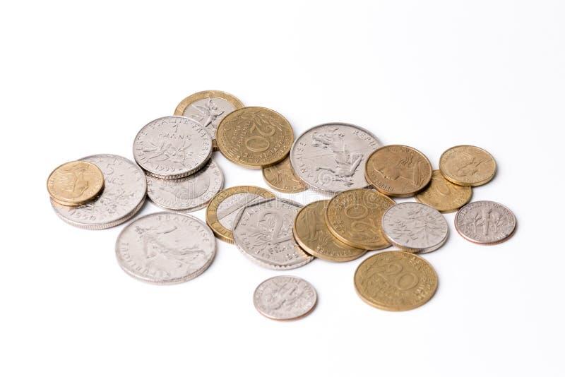 Pièces de monnaie françaises (francs français) blanc images stock